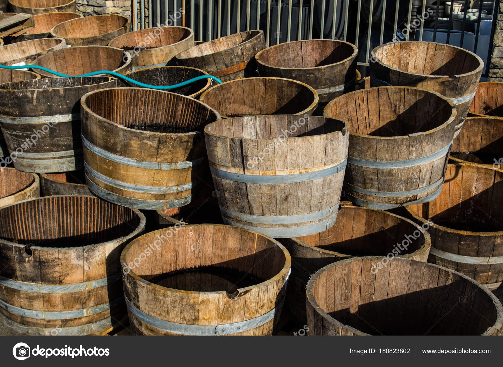 Stacked Old Wooden Half Barrels At Gerden Store Is About To Have