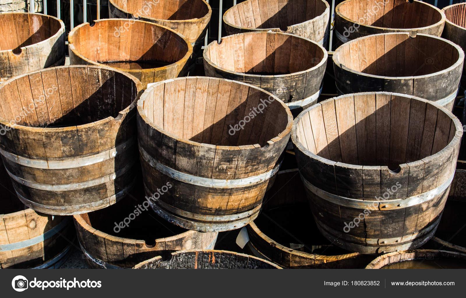 Deco Tonneau De Vin old wooden half barrels. ex wine casks having a second life
