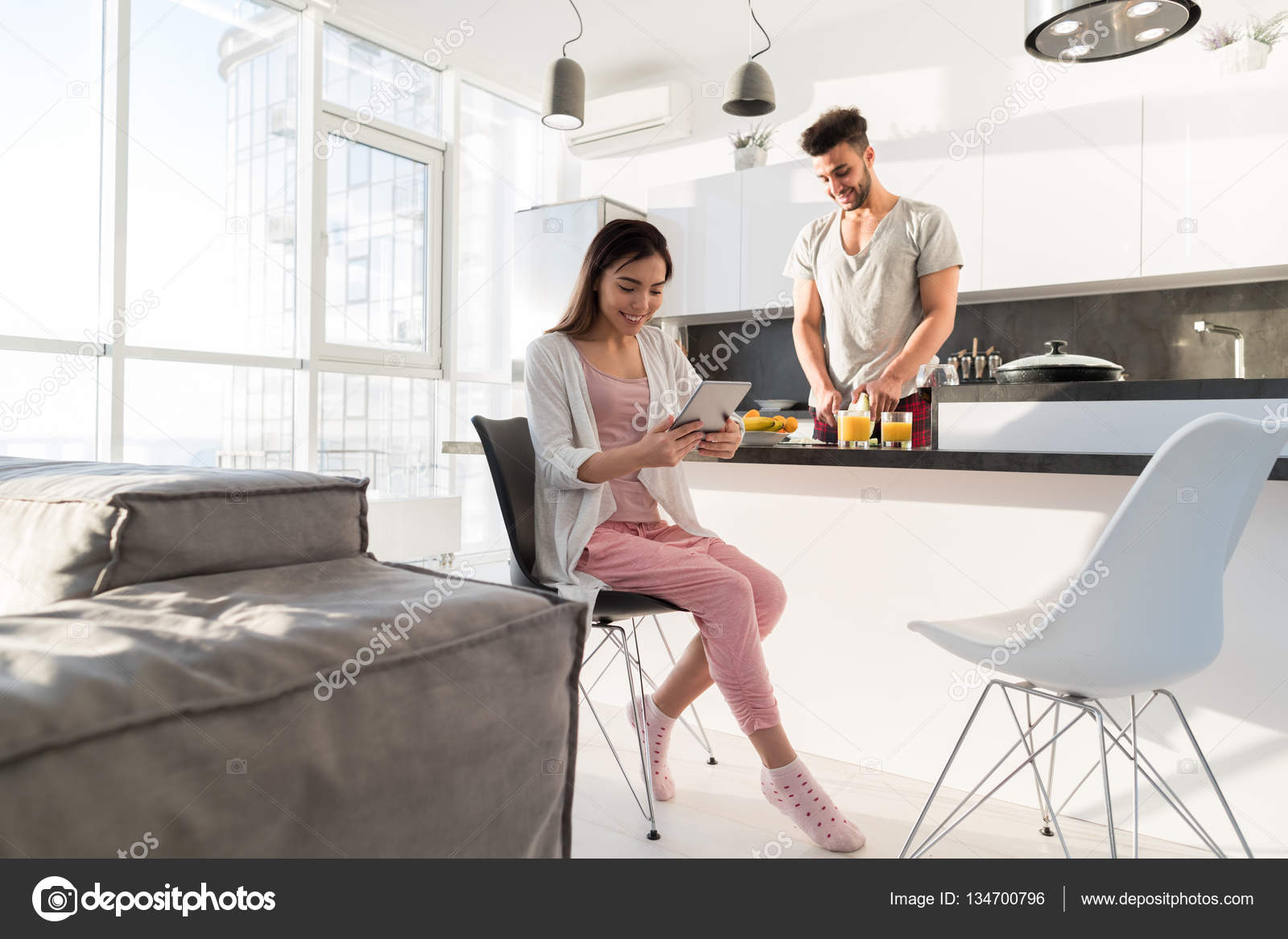 Young Couple Having Breakfast, Asian Woman Using Tablet Computer ...