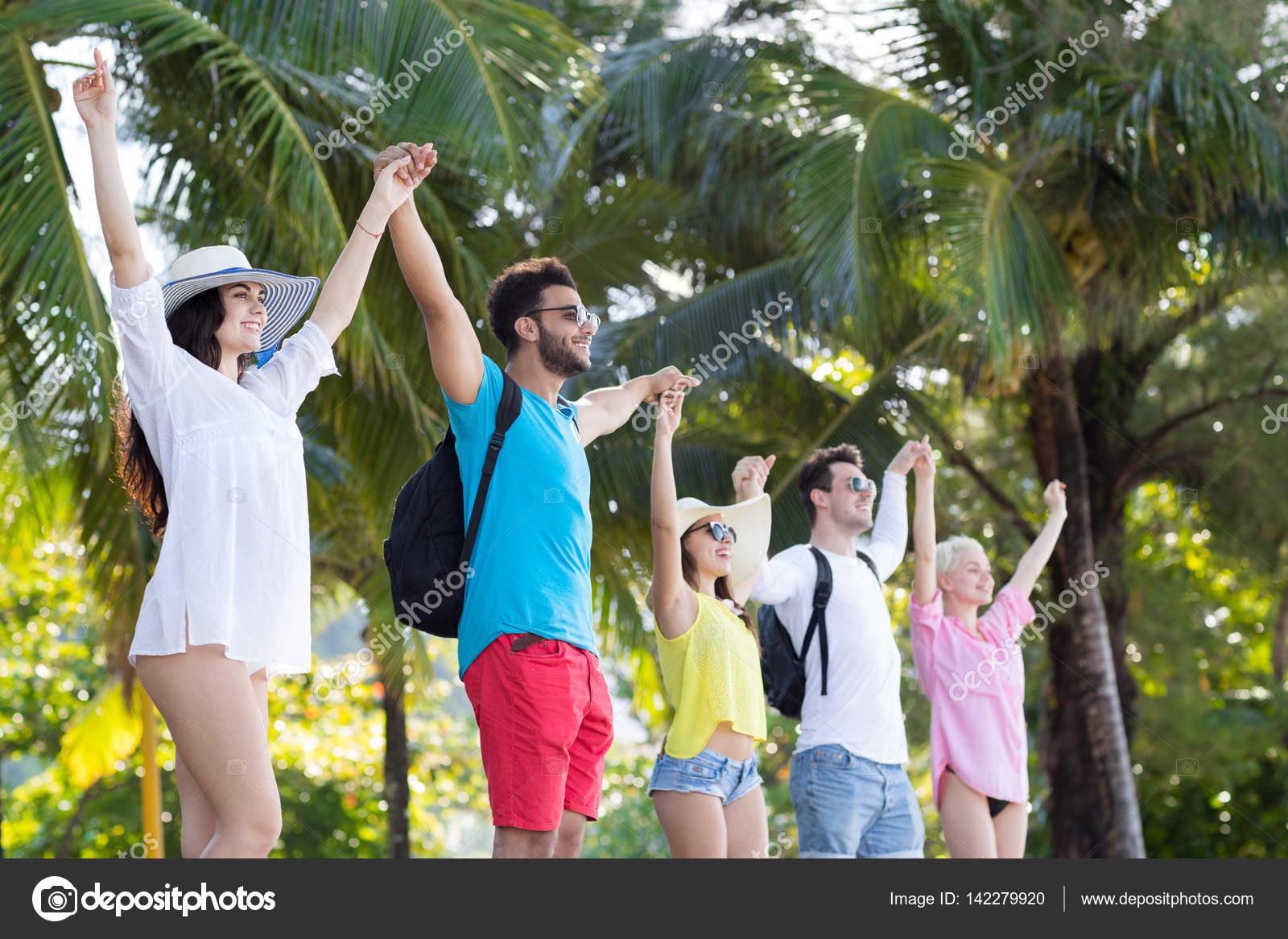 Young People Group Holding Hands Up Tropical Park Palm Trees Happy Smiling Friends Holiday Summer Vacation