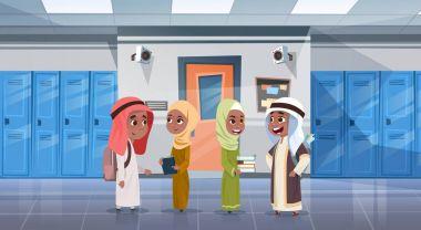 Group Of Arab Pupils Walking In School Corridor To Class Room, Muslim Schoolchildren