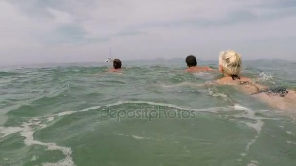 Group Of Young People Swimming In Sea Action Camera POV Of Friends Enjoy Water Together On Beach