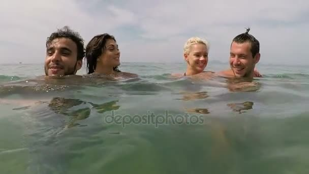 Two Couple Of Friends Having Fun Swimming In Sea Action Camera POV Of Young Playful People Group Together On Beach