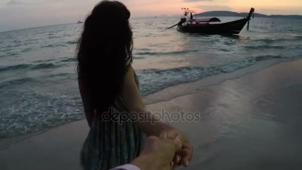 Young Woman Leading Man On Beach At Sunset Action Camera Point Of Vew Of Happy Smiling Girl On Seaside
