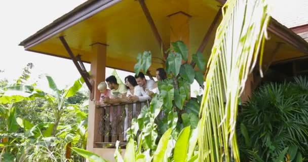 Young People Group Using Gadgets On Summer Terrace In Tropical Forest, Mix Race Friends Surfing Social Media With Cell Smart Phones And Digital Tablet