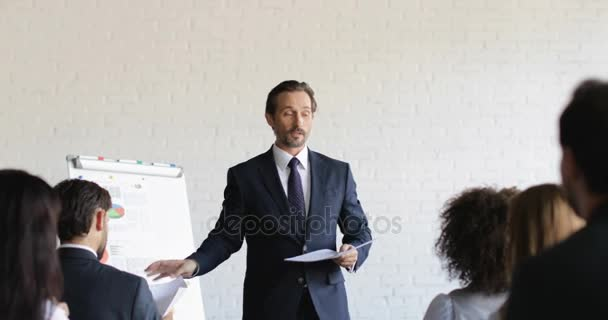 Business Man Leading Training Seminar Give Group Of Businesspeople Tests During Conference Meeting Education Concept