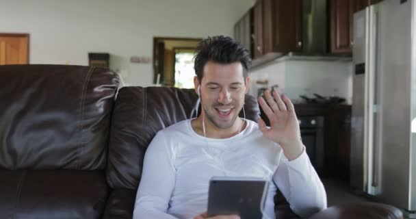 Man Make Online Video Call Using Tablet Computer Sit On Coach In Living  Room, Smiling Guy Speaking Internet Communication