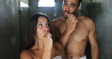 Couple Brushing Teeth In Bathroom, Cheerful Man And Woman Happy Smiling Talking Doing Morning Hygiene