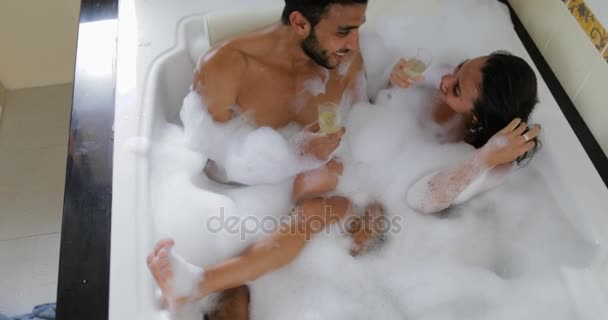 Young Couple In Bath Together Drink Champagne Talking Top Angle View, Man And Woman Lover Enjoy Spa At Home