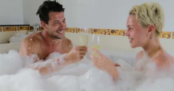 Young Couple In Bath Together Drink Champagne Talking, Man And Woman Lover Enjoy Spa At Home