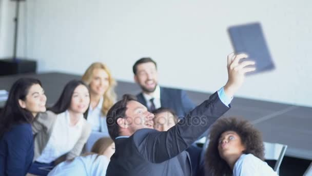 Mix Raced Group Of Business People Take Selfie Photo On Tablet Computer During Presentation Meeting Team Make Self Portrait Together