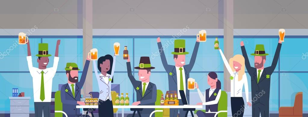 Group Of Workers Celebrate St. Patricks Day In Office Wearing Green Hat And Drinking Beer Together Horizontal Banner