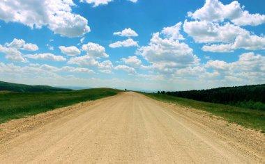 Dirt road and beautiful summer sky