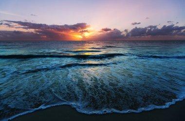 Scenic colorful sunset at the sea coast.