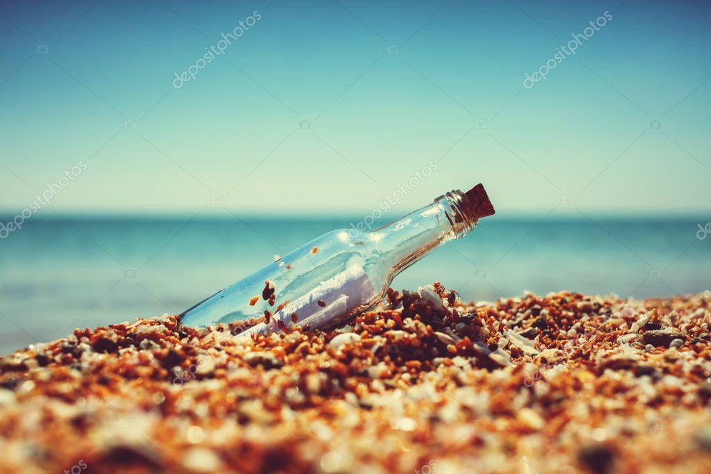 Message in bottle on sea shore