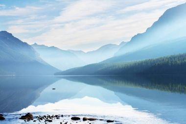 Beautiful Bowman lake with reflection of the spectacular mountains