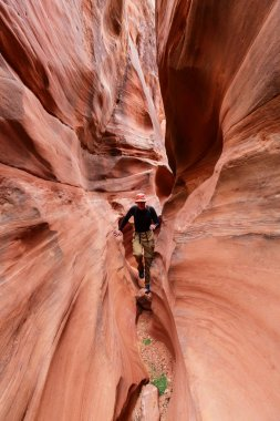 man in Slot canyon in Grand Staircase Escalante National park