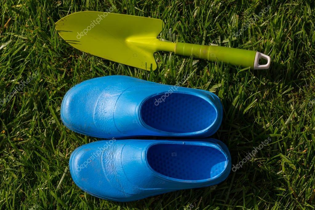 Gardening tools in green grass