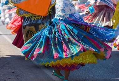 Authentic peruvian dancers on city street
