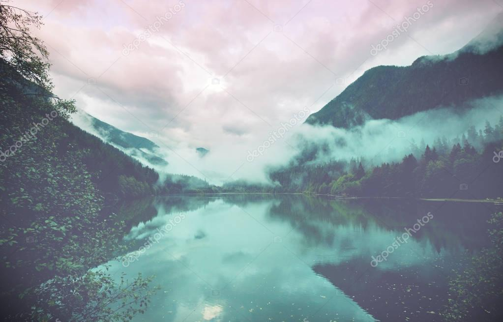 Serenity lake in the mountains stock vector
