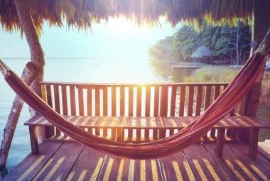 Hammock on the lake at sunset