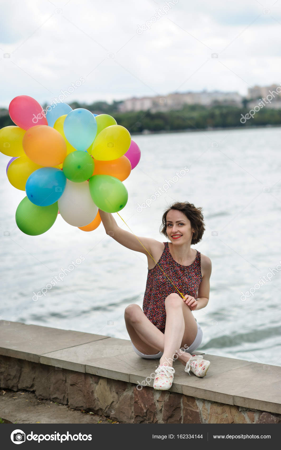Girl with balloons stock photo