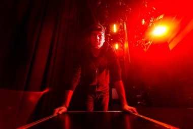 Roadie rolling a flightcase on the stage
