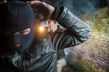 Officer Pointing Gun Towards gangster