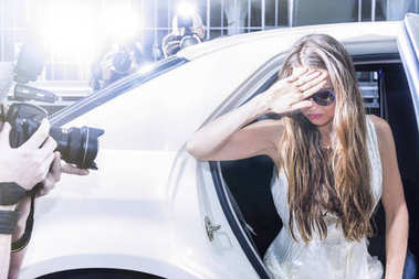 Actress stepping out of a limousine
