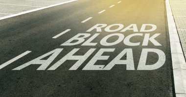 Road block ahead message on the highway lane