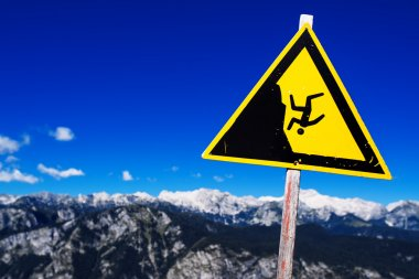 Warning sign - possible fall from the mountain cliff