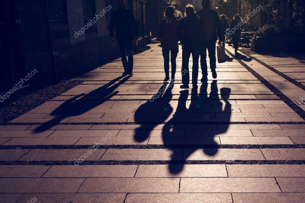 Silhouette Of People Walking On Street: Silhouettes Of People Walking On City Street