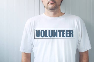 Guy wearing shirt with Volunteer label printed on chest