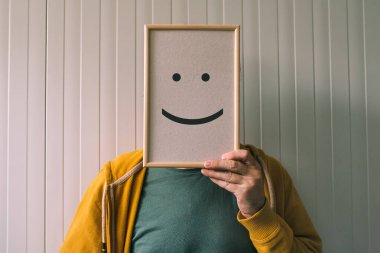 Put a happy optimistic face on, happiness and cheerful emotions