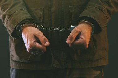 Handcuffed soldier in prison