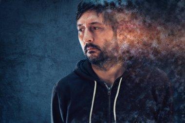 Mental health concept with depressive man dissolving