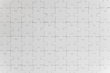 Blank white jigsaw puzzle pieces completed