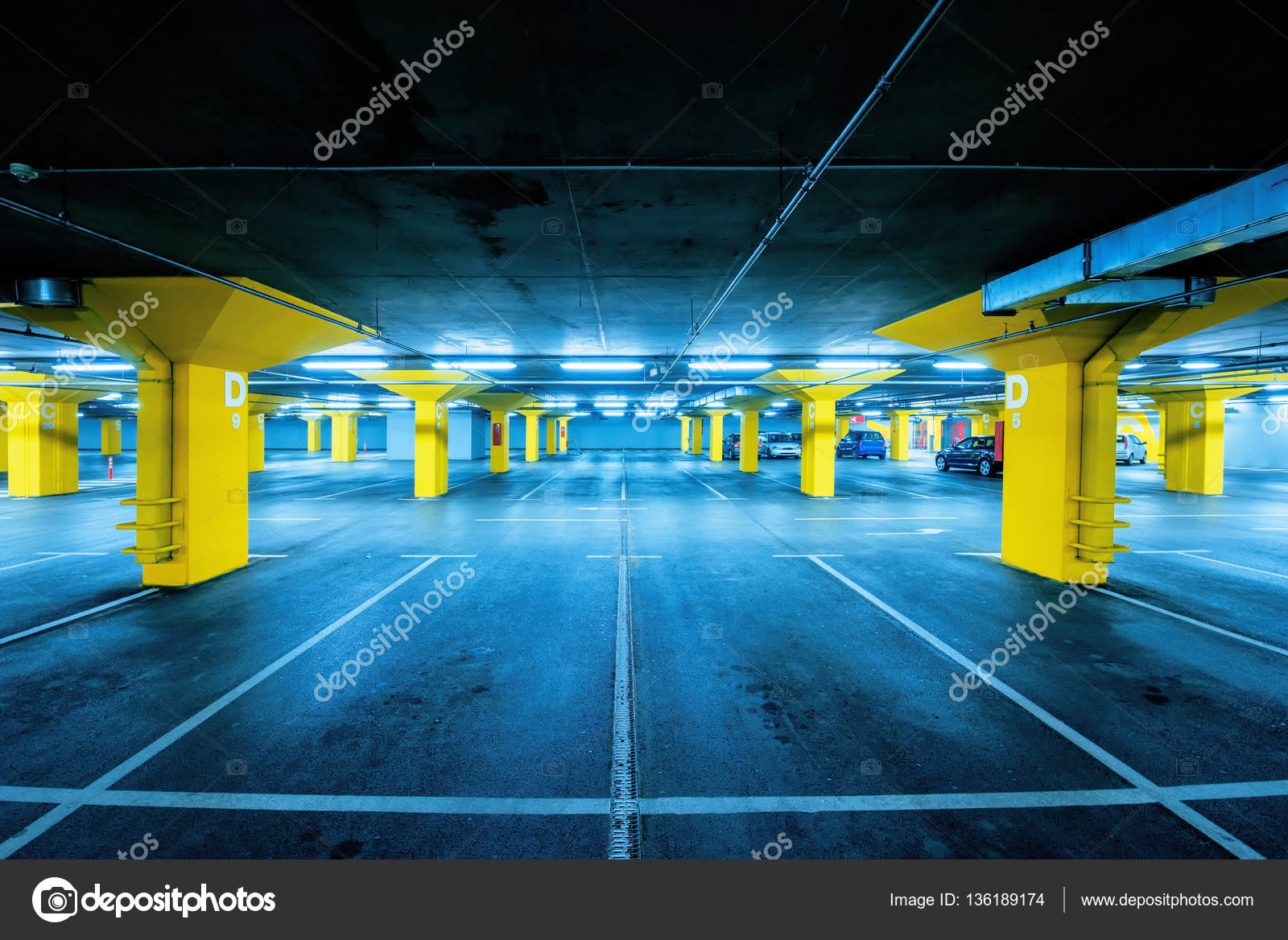 Underground Garage Parking Lot With Few Cars And Empty