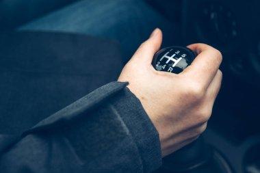 Female driver shifting gear manually