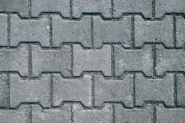 Concrete H shaped paving slabs surface