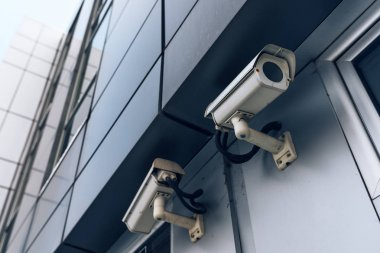 Two surveillance cameras on modern building