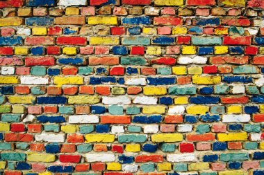 Multicolored painted bricks, exterior wall as background