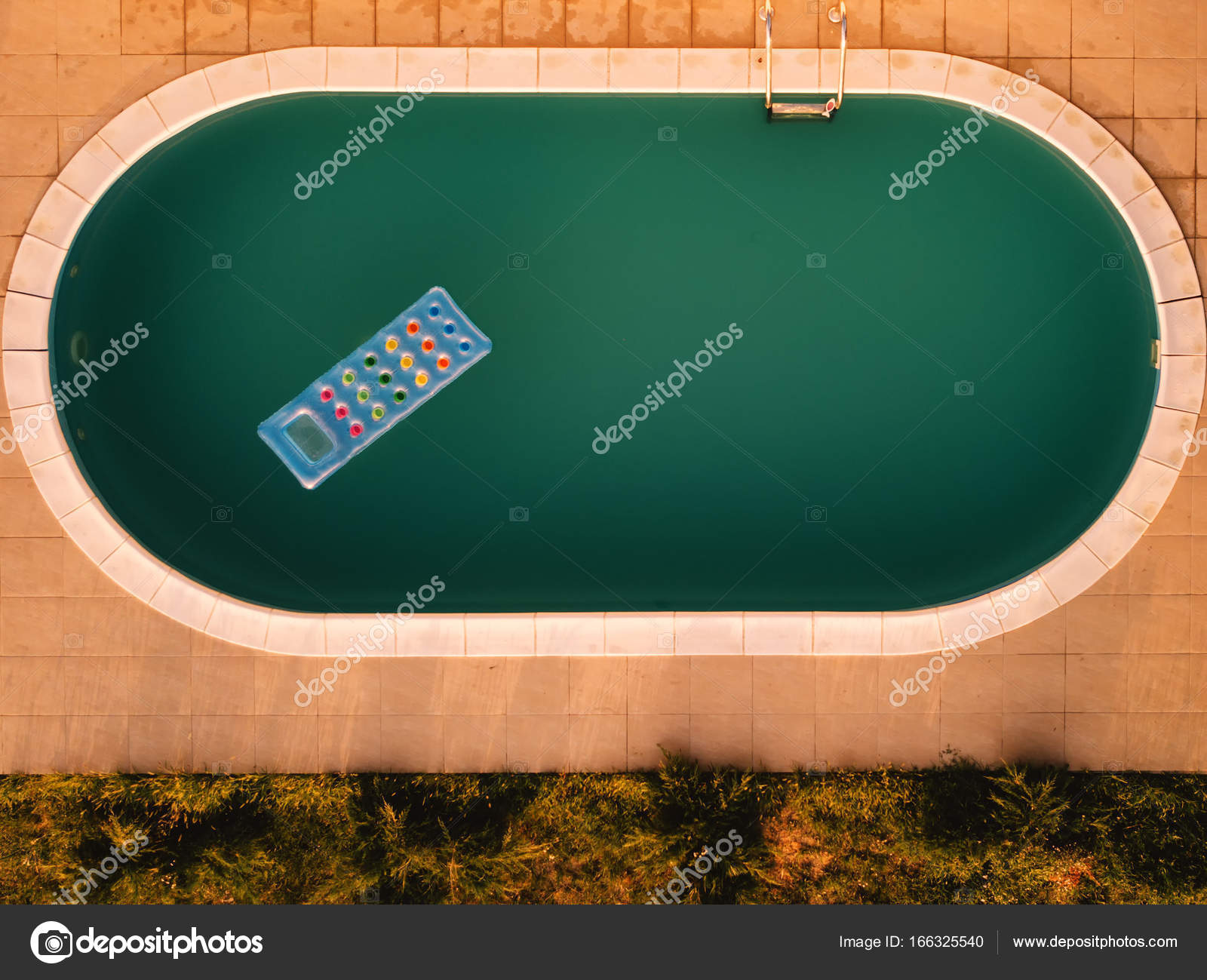 aerial view of inflatable mattress in swimming pool summer fun and enjoyment leisure activity equipment in the poolside water from drone point of view - Rectangle Pool Aerial View