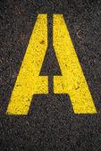 Letter A on asphalt road
