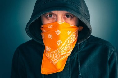 Portrait of masked criminal male person