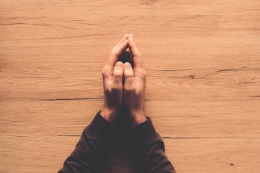 Man praying, overhead view