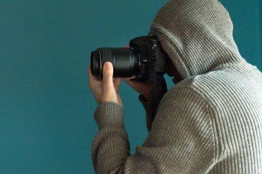 Photographer holding full frame sensor DSLR camera