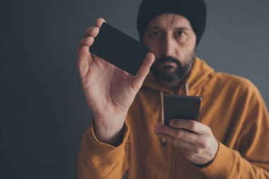 Casual man showing blank mock up credit card