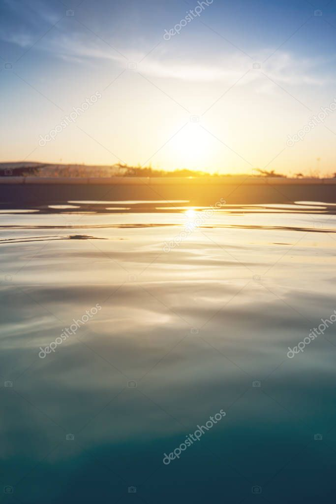 Outdoor swimming pool in sunset