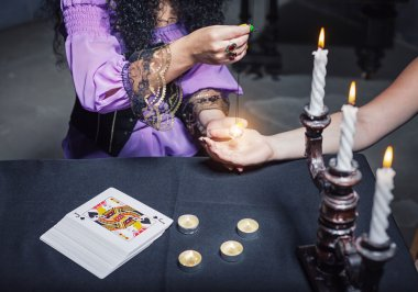 Sorceress reading somebody's hand